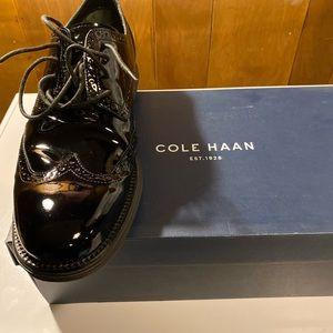 Black patent leather Wingtip shoes